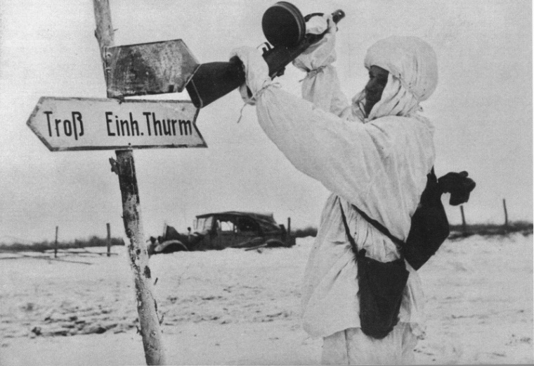Soviet soldier with a rifle butt hit by a German road sign.