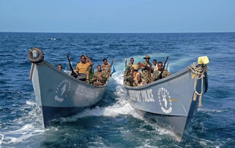 Полиция патрулирует пунтлендский порт Босасо. После победы над пиратами он стал крупнейшим экспортным хабом Сомали, ноябрь 2013. Фото: Mohamed Abdiwahab / AFP / East News