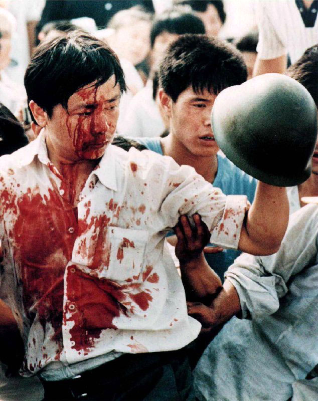 File photo of a blood-covered protester after violent clashes with Chinese military forces in Beijing's Tiananmen Square